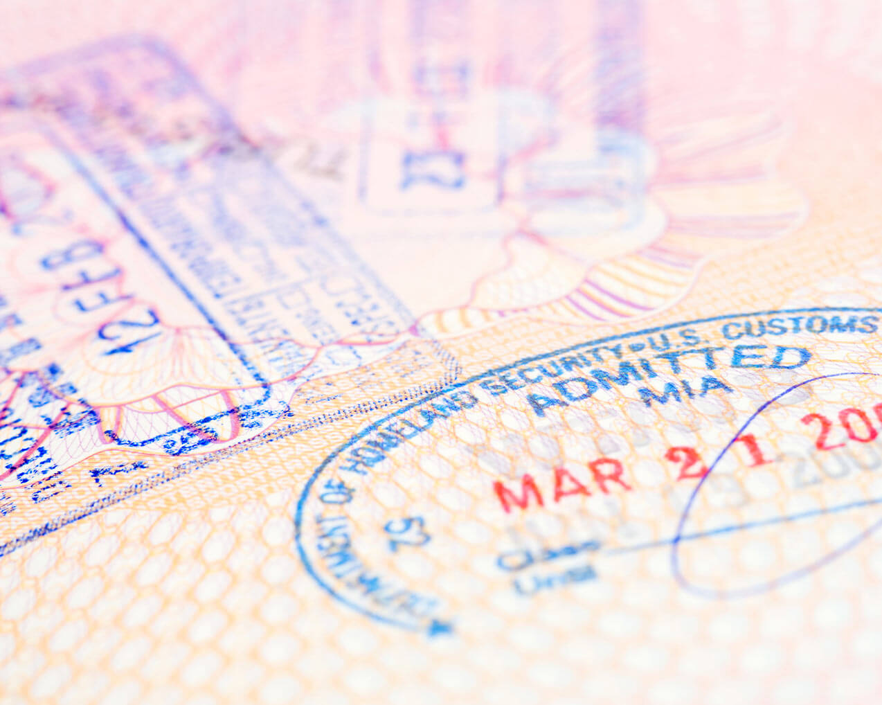 visa stamps on open passport
